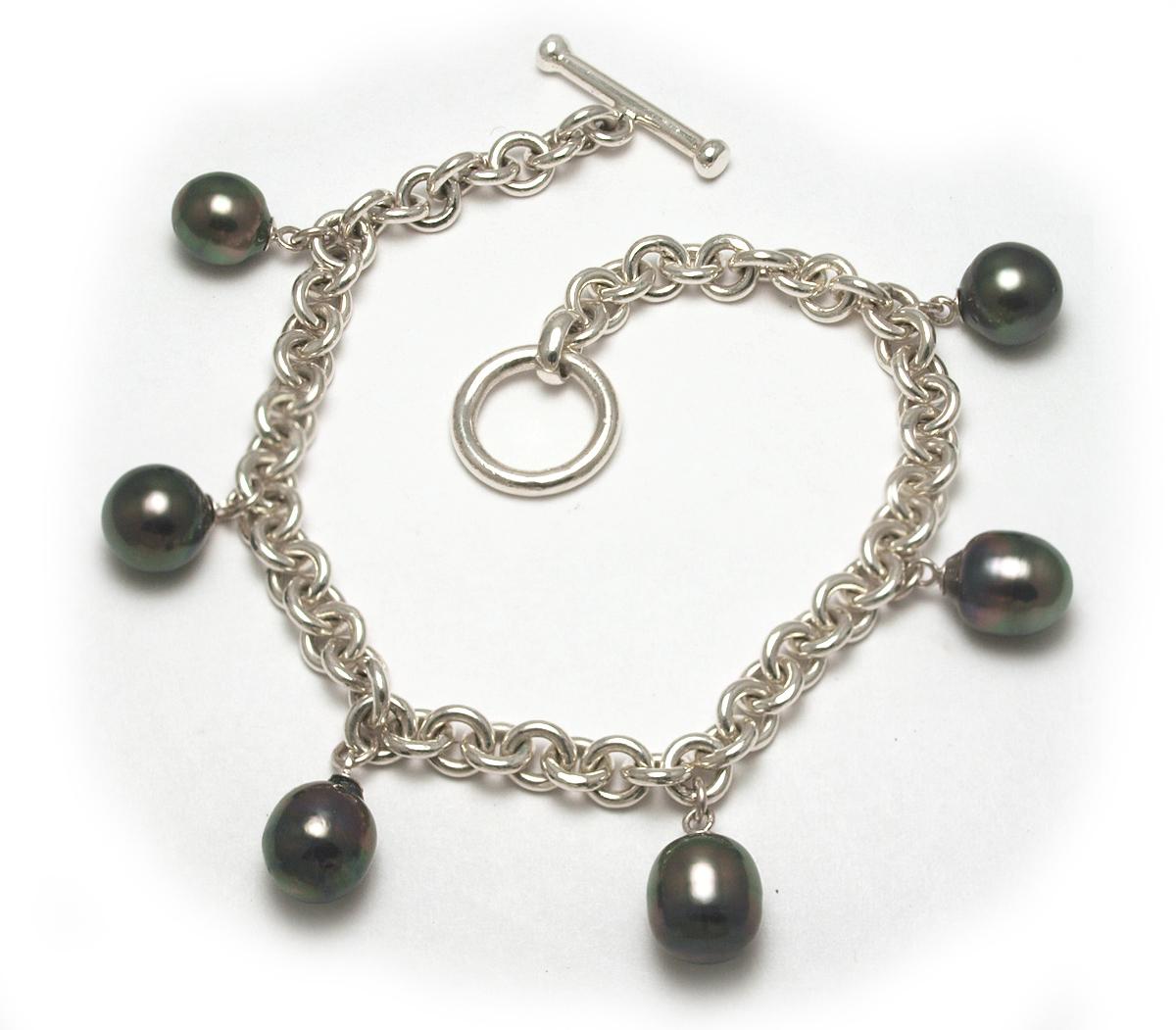tahitian pearl charm bracelet with semi baroque tahitian